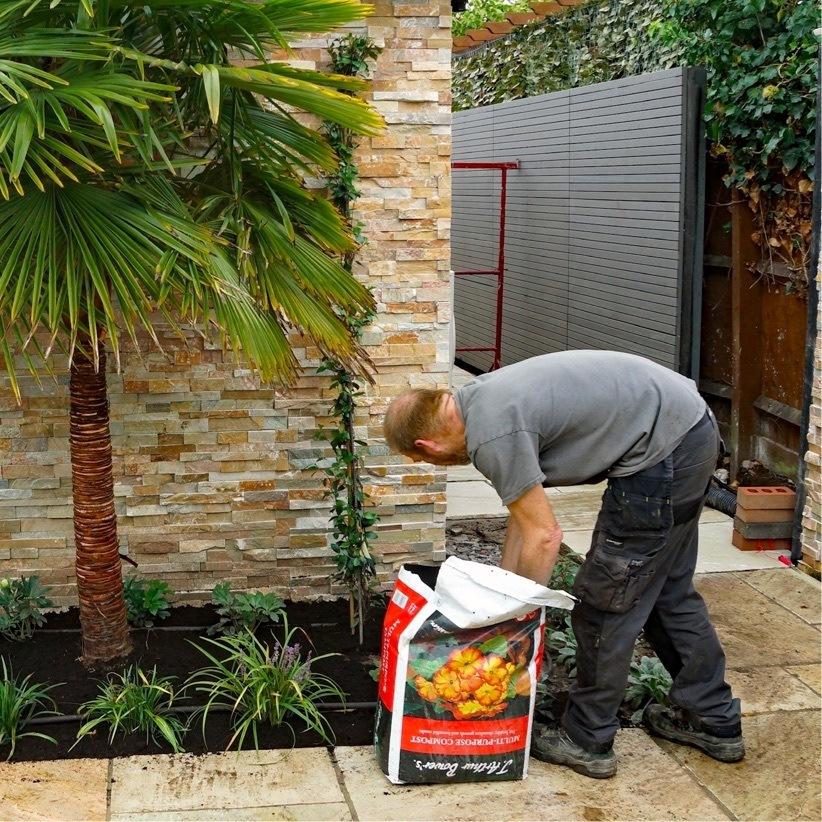 Man conducting a garden design project in Leamington Spa.